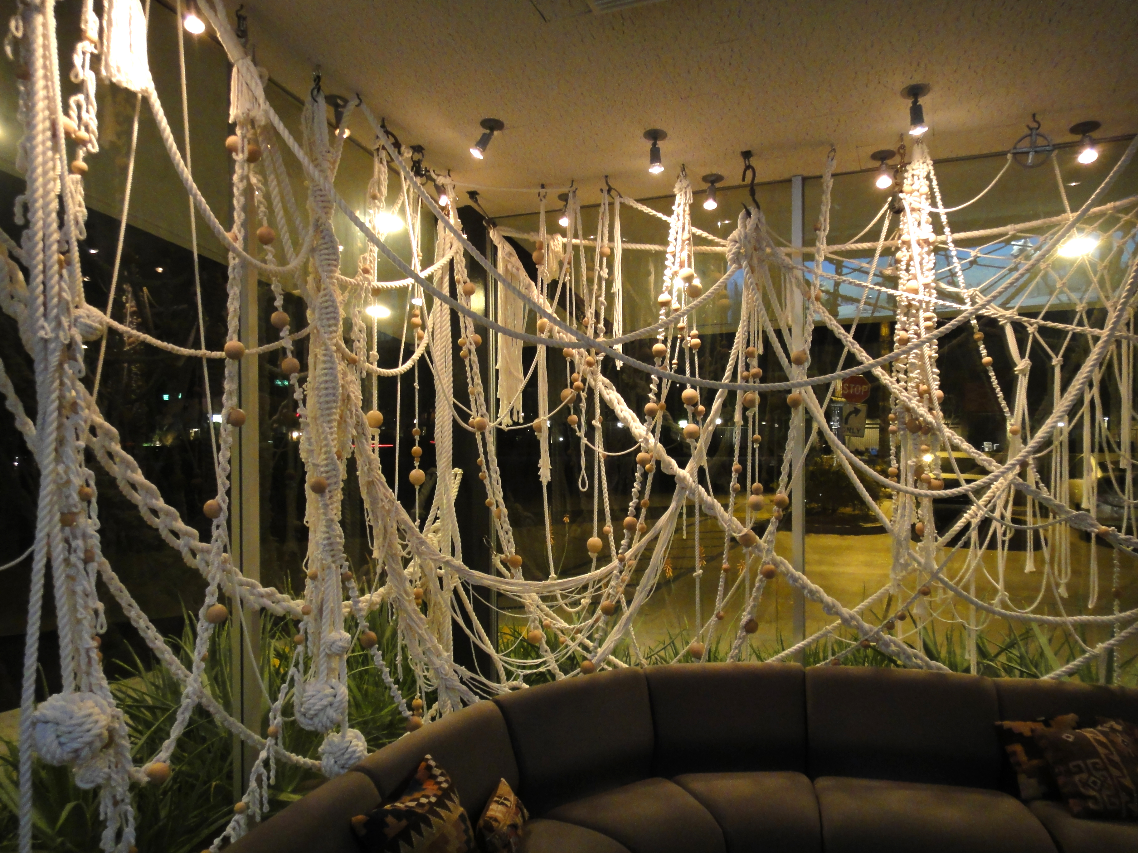 Knotted Macramé rope curtain<br>1.5 miles of cotton rope, wooden balls<br>Lobby installation 2009