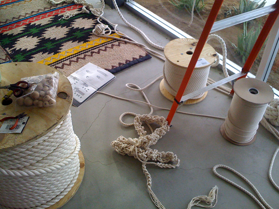 Making of the Knotted Macramé rope curtain<br>1.5 miles of cotton rope, wooden balls<br>Lobby installation 2009